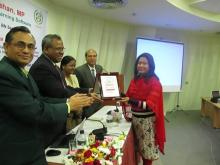 Ms. Nomita Akter Mukti receiving crest on behalf of honourable MP